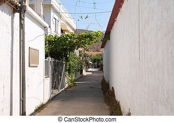 Narrow street - A narrow street on the island of Crete in...