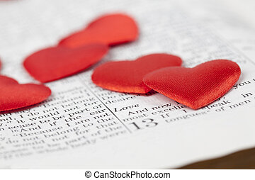 Bible and hearts - Bible open to 1st Corinthians 13, a...