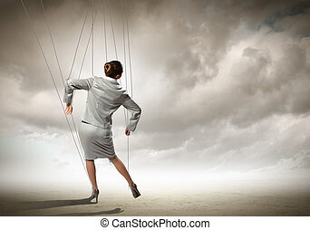 Puppet businesswoman - Image of businesswoman hanging on...