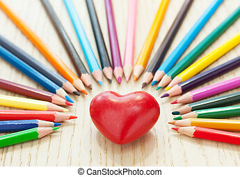 Heart and pencil - Heart in the middle of colour pencil on...