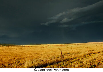 Ominous Storm Over Prairie - Dark, ominous storm clouds roll...