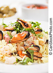 Seafood risotto with mussels and shrimps, selective focus