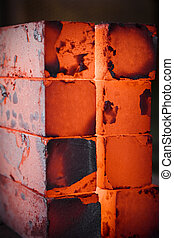 iron blocks - piles of hot iron blocks in foundry. Narrow...