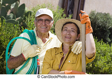 gardening - Portrait of senior Italian couple in garden,...
