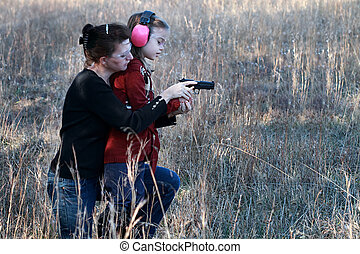 Mom and Daughter Shooting - Mother teaching her young...