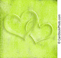 Card lovers, intertwined hearts on green background