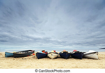 Fishing Boats on Bournemouth Beach - Fishing boats under a...