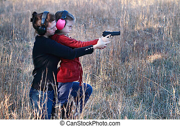 Mom and Daughter Practicing Shooting - Mother teaching her...