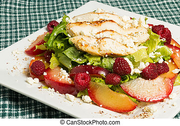 Chicken salad with plums and raspberries