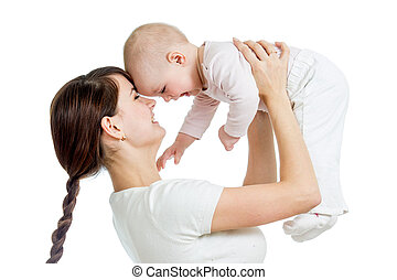 loving mother playing with her child on white background