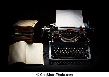 retro typewriter with stack of book and one opened book
