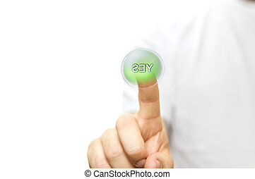 Finger pressing a green YES button