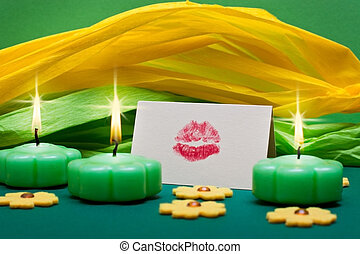 background with candles and romantic kiss mouth -...