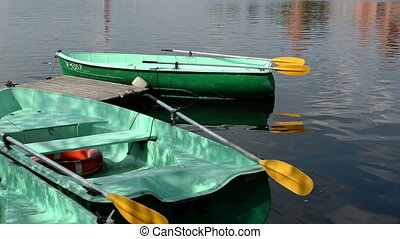 boat rent water ripple - Boat rent place on lake. Boats on...