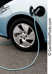 Charging of an electric car - Electric car at charge point