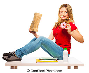 School teen girl eating donuts