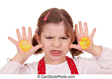 angry little girl with angry smiley on hands