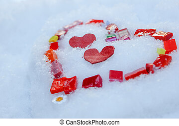 Mosiac of glass hearts on snow - Valentine heart . Colorful...
