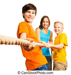 Three happy kids pull the rope - Team concept three happy...