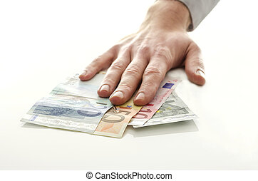 Man holding his hand over Euro banknotes - Man holding his...