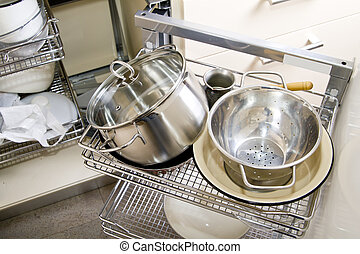Pile of pots and pans in the cupboard