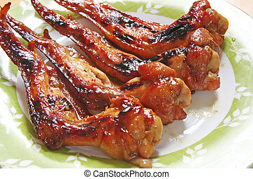 Grilled chicken wings - Grilled cooked chicken wings on...
