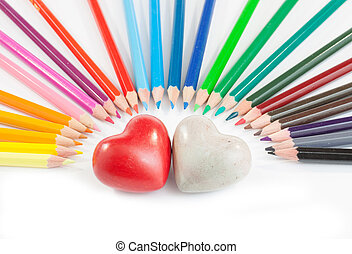 Two hearts with coloured pencil - Two heart in the middle of...
