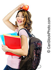 Happy female student with red apple above her head isolated...