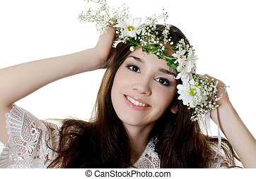 Portrait of the beautiful girl with flowers in hair