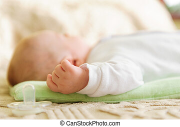 Cute newborn baby sleeping in bed Shallow depth of field