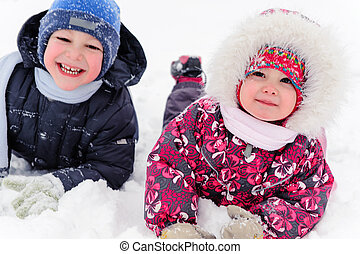Two cute children playing in winter - Two cute children...