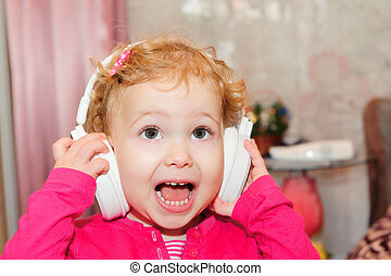 Cute little girl singing in headphones - Cute little girl...
