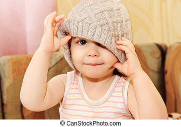 Portrait of baby wearing knit cap - Close up portrait of...