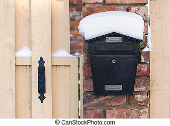 Mailbox at winter - Black mailbox covered with snow outside...