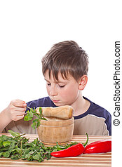 Boy preparing breakfast on a white background