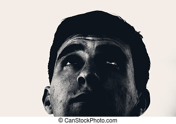 Man staring up - An image of young man staring up