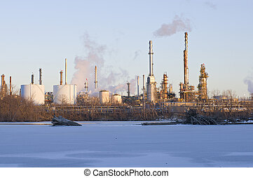Oil and Petroleum Refinery Along Frozen Mississippi River -...