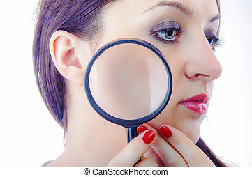Women with magnifying glass