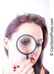 Women with magnifying glass - An image of Women with...