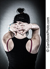 Hostage - An image of kidnapped girl with cross hands on...