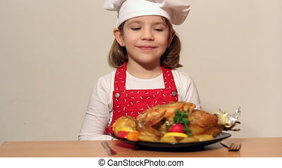 little girl cook with chicken