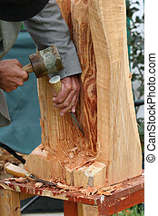 Craftsman Wood Sculpting - Hands of an elderly man, carving...