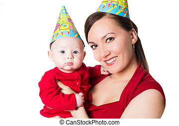 Happy mom and baby celebrating happy birthday on isolated...