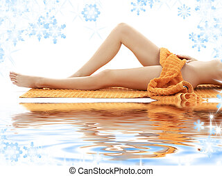 long legs of girl with orange towel on white sand - long...