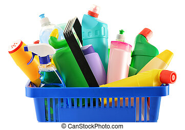 Shopping basket with detergent bottles isolated on white -...