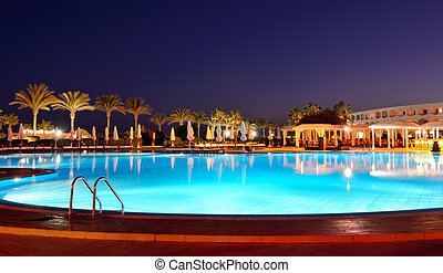 Sunset and swimming pool at the luxury hotel, Sharm el...