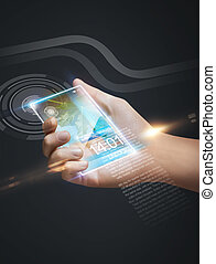 hand holding smart phone - closeup picture of hand holding...