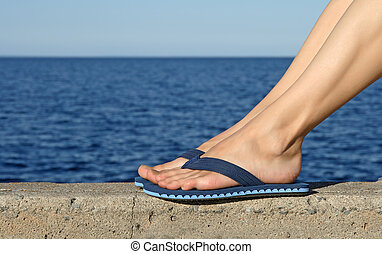 Female feet wearing blue flip-flops - Female feet in blue...