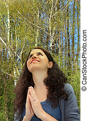 Grateful pray - Outdoors portrait of the beautiful woman...