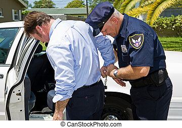 Arrested in Public - Businessman being handcuffed and placed...